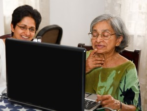 elderly woman at laptop with daughter